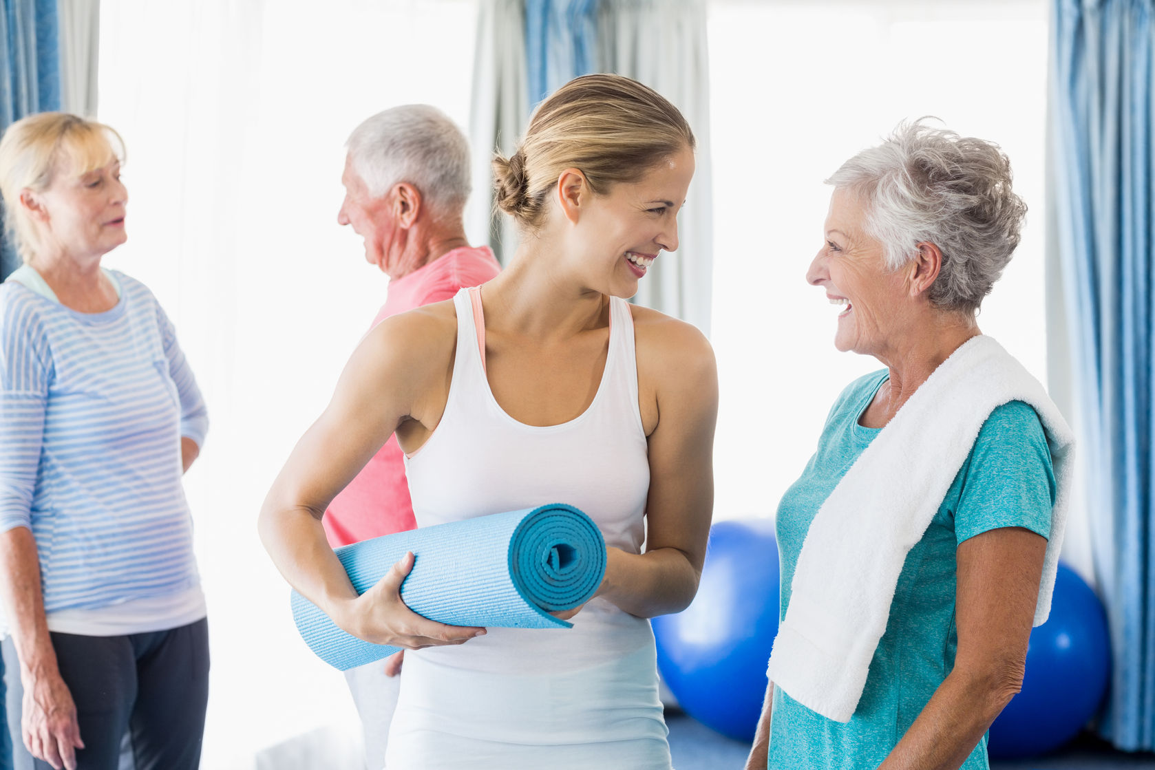 58320915 - instructor standing together with seniors during sports class